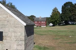Powder magazine (foreground) with Ebenezer Avery House in the background.