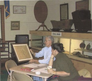 David Rose and Leslie Evans reading the Monument of Groton Heights Document